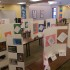 Students display personal projects in the library.