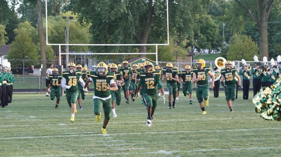 The Huskies take the field against Indianola High School, led by Senior, Romelo Spivey (55) MC Photography Photo
